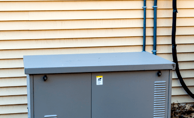 Outdoor generator next to a home