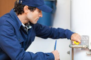 plumber-working-on-hot-water-heater